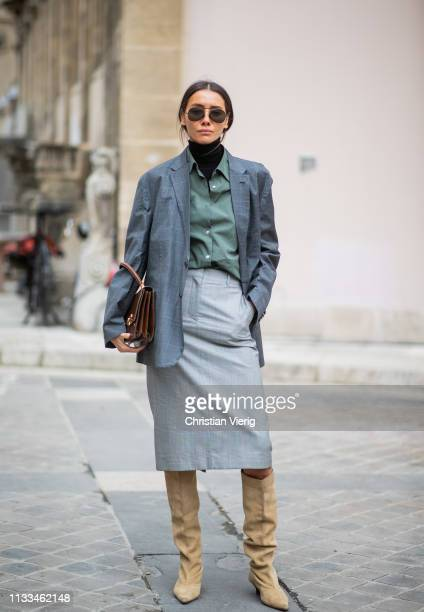 Julie Pelipas is seen wearing grey blazer skirt beige boots turtleneck olive button shirt outside Thom Browne during Paris Fashion Week Womenswear...