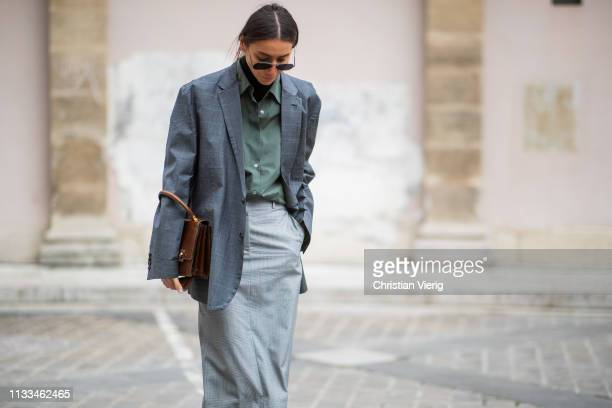 Julie Pelipas is seen wearing grey blazer, skirt, turtleneck, olive button shirt outside Thom Browne during Paris Fashion Week Womenswear Fall/Winter...