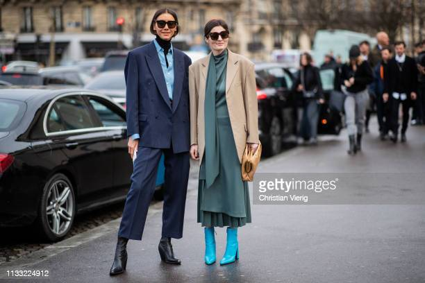 Julie Pelipas is seen wearing navy suit and Irina Linovich is seen wearing beige blazer green dress outside Haider Ackermann during Paris Fashion...