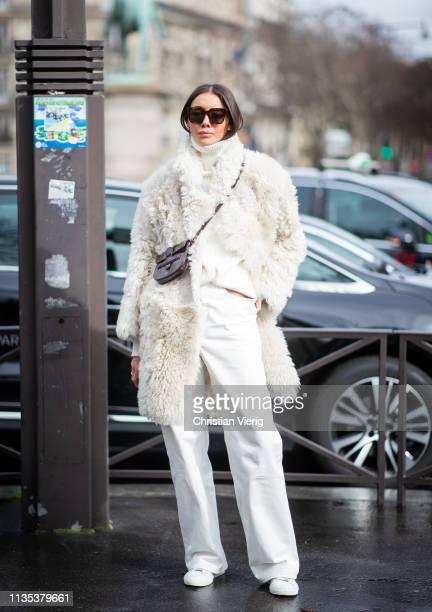 Julie Pelipas is seen wearing white turtleneck, white teddy jacket, brown mini Celine bag outside Miu Miu during Paris Fashion Week Womenswear...