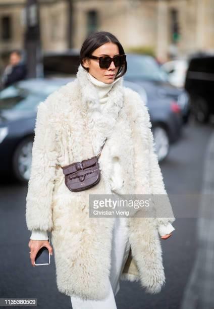 Julie Pelipas is seen wearing white turtleneck white teddy jacket brown mini Celine bag outside Miu Miu during Paris Fashion Week Womenswear...