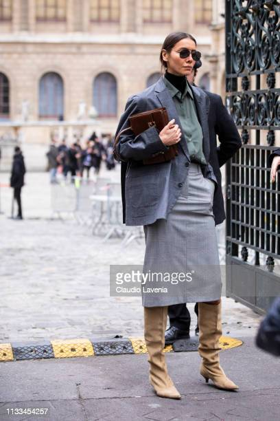 Julie Pelipas wearing a black turtleneck top military green shirt grey skirt grey blazer cream boots and brown bag is seen outside Thom Browne on Day...