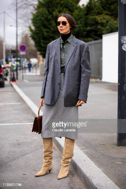 Julie Pelipas wearing a black turtleneck top military green shirt grey skirt grey blazer cream boots and brown bag is seen outside Balenciaga on Day...