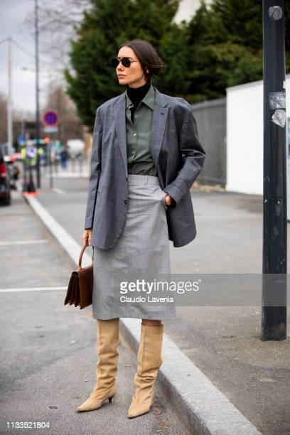 Julie Pelipas, wearing a black turtleneck top, military green shirt, grey skirt, grey blazer, cream boots and brown bag, is seen outside Balenciaga...