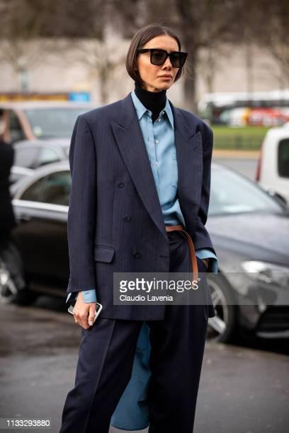 Julie Pelipas wearing a light blue shirt and dark grey suit is seen outside Haider Ackermann on Day 6 Paris Fashion Week Autumn/Winter 2019/20 on...