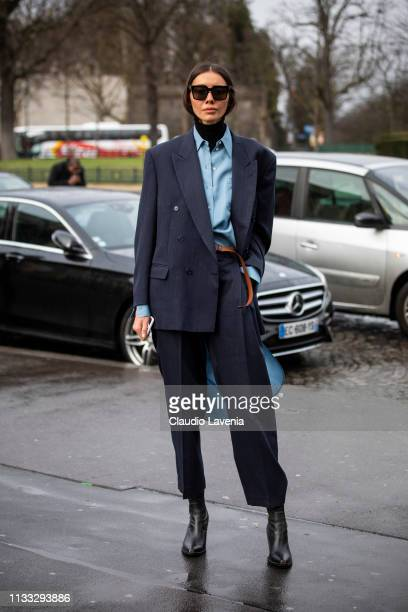 Julie Pelipas wearing a light blue shirt black boots and dark grey suit is seen outside Haider Ackermann on Day 6 Paris Fashion Week Autumn/Winter...