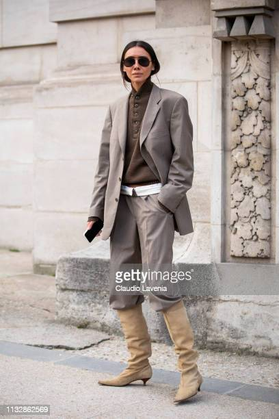 Julie Pelipas wearing a military green top taupe suit and beige boots is seen outside Paco Rabanne on Day 4 Paris Fashion Week Autumn/Winter 2019/20...
