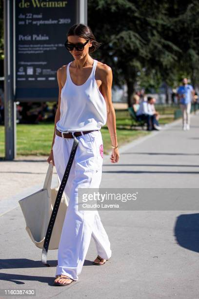 Julie Pelipas wearing a white top white pants black sandals and cream tote bag is seen outside Giorgio Armani Prive show during Paris Fashion Week...
