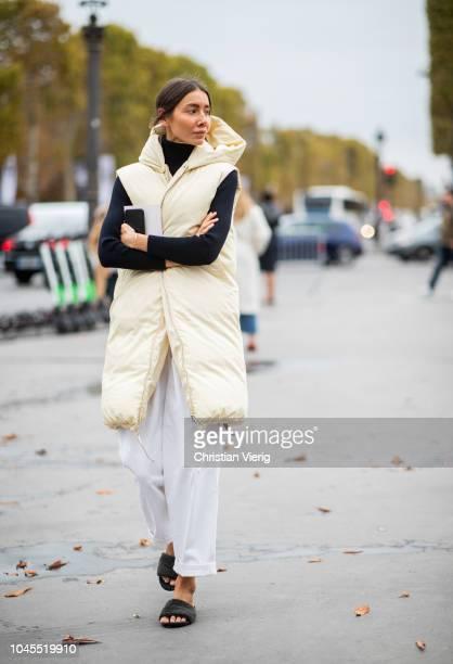 Julie Pelipas wearing beige sleeveless hooded vest is seen outside Chanel during Paris Fashion Week Womenswear Spring/Summer 2019 on October 2 2018...