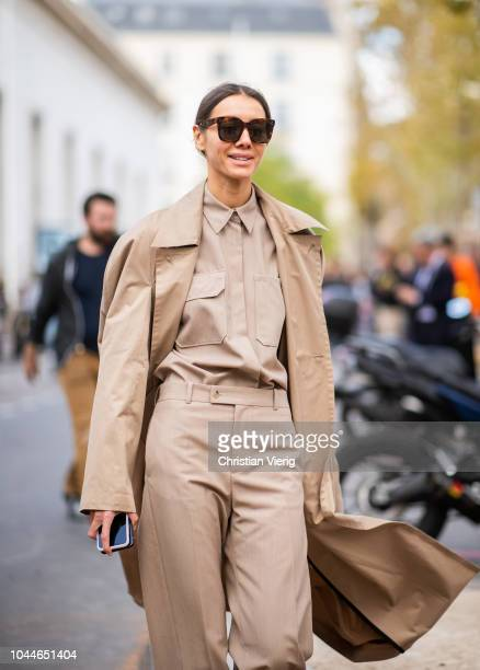 Julie Pelipas wearing beige trench coat pants button shirt is seen outside Sacai during Paris Fashion Week Womenswear Spring/Summer 2019 on October 1...