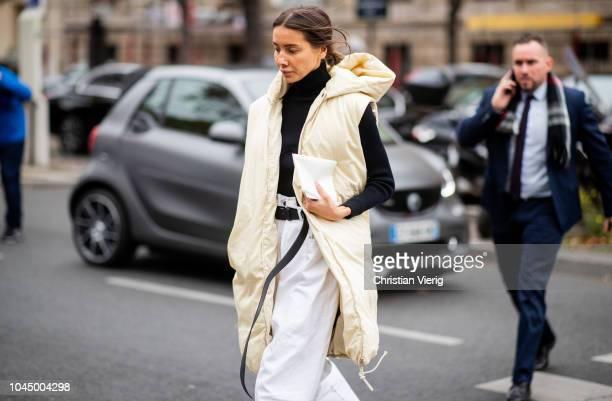 Julie Pelipas wearing hooded vest coat is seen outside Miu Miu during Paris Fashion Week Womenswear Spring/Summer 2019 on October 2 2018 in Paris...