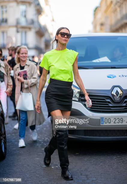 Julie Pelipas wearing neon tshirt black mini skirt black boots is seen outside Y/PROJECT during Paris Fashion Week Womenswear Spring/Summer 2019 on...
