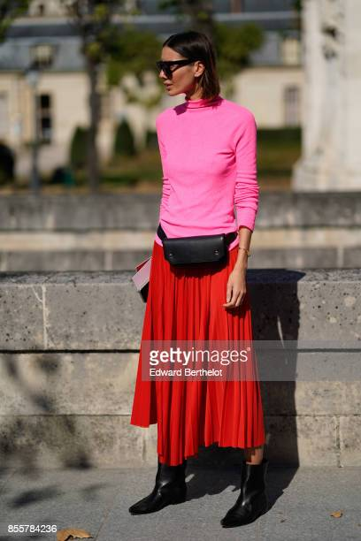 Julie Pelipas wears a pink top a red pleated skirt outside Nina Ricci during Paris Fashion Week Womenswear Spring/Summer 2018 on September 29 2017 in...