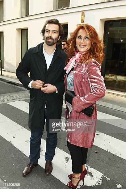 Julie Pietri and guest attend the Paul Loup Sulitzer book signing at Club Des Saints-Peres on June 25, 2013 in Paris, France.