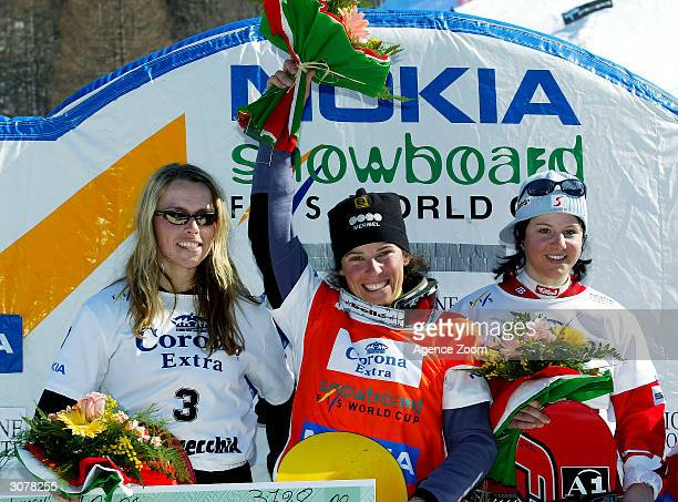 Julie Pomagalski of France celebrates victory in the FIS World Cup Womens Snowboardcross final with Line Oestvold of Norway in Second place and...