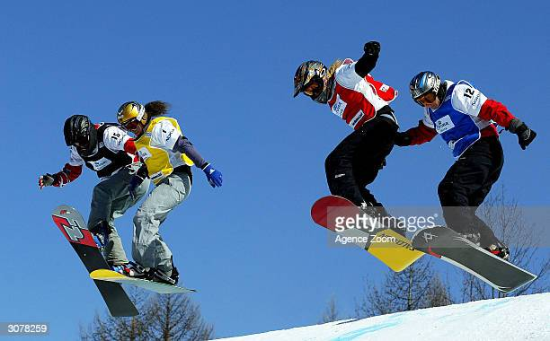 Julie Pomagalski of France competes in the FIS World Cup Womens Snowboardcross final with Line Oestvold of Norway and Susanne Moll of Austria on...