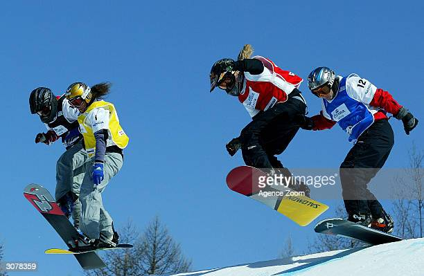 Julie Pomagalski of France competes in the FIS World Cup Womens Snowboardcross final with Line Oestvold of Norway in and Susanne Moll of Austria on...