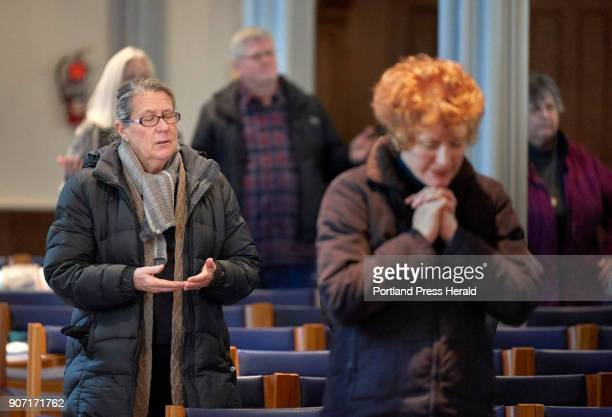 Julie Rice left holds her hands together while saying the Our Father prayer during the noon mass in the Sacred Heart Chapel at the Cathedral of the...