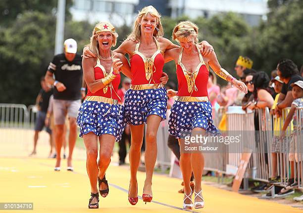 Julie Richardson, Sharon Richardson and Michelle Sorensen who are triplets run while wearing high heeled shoes as they take part in a Guinness World...