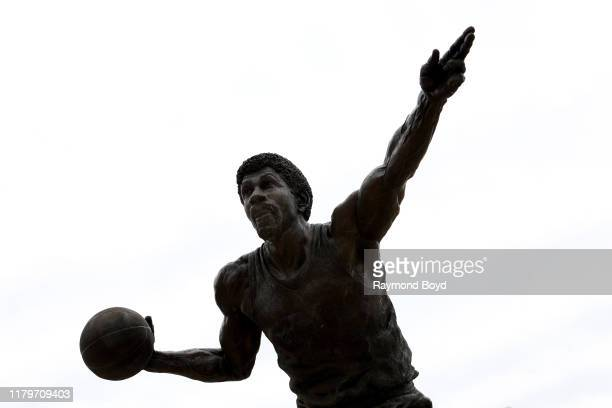 Julie Rotblatt- Amrany and Omri Amrany's Earvin 'Magic' Johnson 'Always A Champion' statue stands outside Gilbert Pavilion, home of the Michigan...