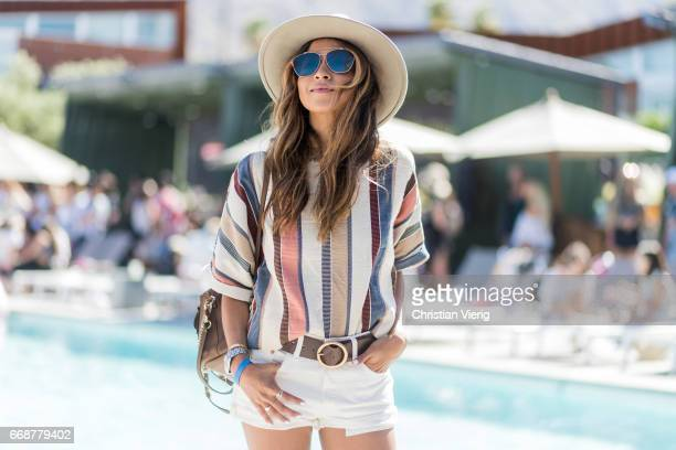 Julie Sarinana wearing a hat white shorts boots striped shirt Chloe backpack during day 1 of the 2017 Coachella Valley Music Arts Festival Weekend 1...