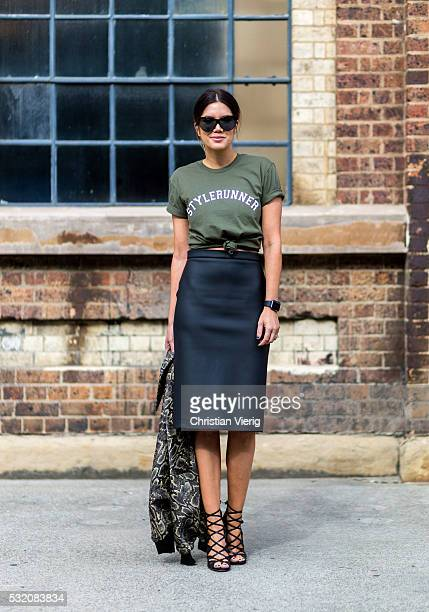 Julie Stevanja wearing an olive Stylerunner tshirt a bomber jacket and black skirt and heels outside C Meo Collective at MercedesBenz Fashion Week...