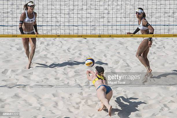 Julie Sude of Germany center dives for the ball during semifinal match of the 2014 FIVB Beach Volleyball World Tour on May 11 2014 in Puerto Vallarta...