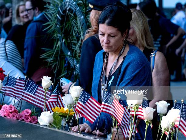 Julie Sweeney Roth, whose husband Brian Sweeney died when United Airlines flight 175 hit the World Trade Center on Sept. 11 touches his name at the...