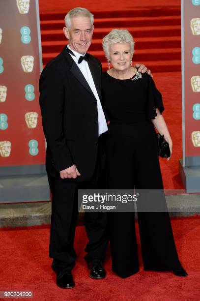 Julie Walters and Grant Roffey attend the EE British Academy Film Awards held at Royal Albert Hall on February 18 2018 in London England