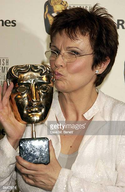 """Julie Walters poses in the pressroom following the """"The British Academy Television Awards"""" at the Grosvenor House Hotel on April 18, 2004 in London."""
