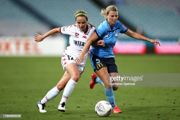 Julie-Ann Russell of the Wanderers and Ally Green of Sydney FC contest the ball during the round four W-League match between Sydney FC and the...