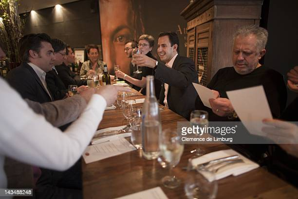 Julien Balkany meeting and toasting with Chefs and Maitres Cuisiniers of France at French Restaurant Jeanne and Gaston on March 18, 2012 in New York...