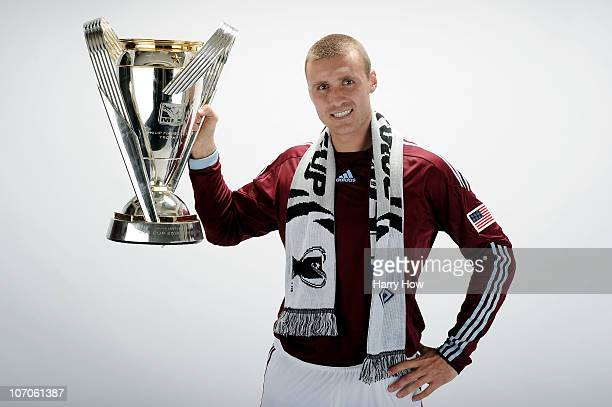 Julien Baudet of the Colorado Rapids poses with the Philip F Anschutz MLS Cup trophy following the MLS Cup final at BMO Field on November 21 2010 in...