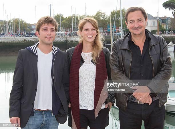 Julien Baumgartner Emilie Piponnier and Wladimir Yordanoff pose during the 'Un petit bout de France' Photocall at La Rochelle Fiction Television...
