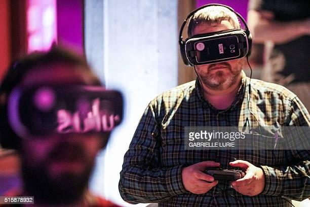 Julien Beasly tries out the Minecraft for Gear VR at a press demonstration at The Village event space in San Francisco California on March 15 2016 /...