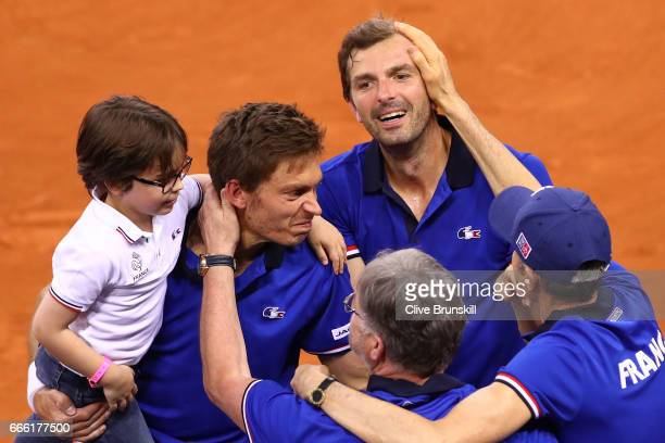 Julien Benneteau and Nicolas Mahut of France celebrate victory in their doubles match against Jamie Murray and Dominic Inglot of Great Britain during...
