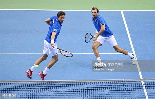 Julien Benneteau and Nicolas Mahut of France in action against Benjamin Becker and Andre Begemann of Germany in their doubles match during day two of...