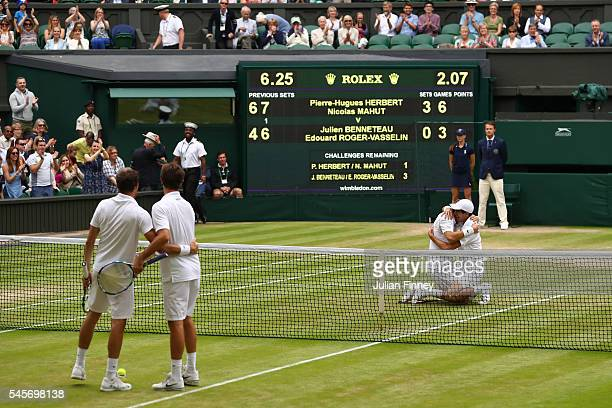 Julien Benneteau of France and Edouard RogerVasselin of France watch on in the Men's Doubles Final as Nicolas Mahut of France and PierreHugues...