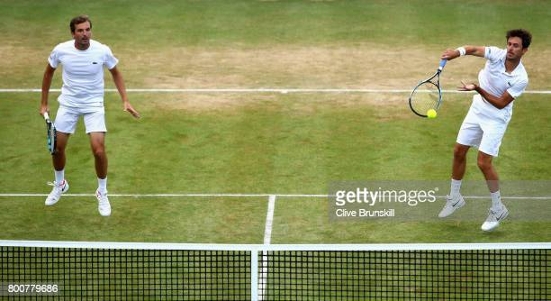 Julien Benneteau of France and partner Edourd RogerVasselin of France return the ball during the mens doubles final against Jamie Murray of Great...