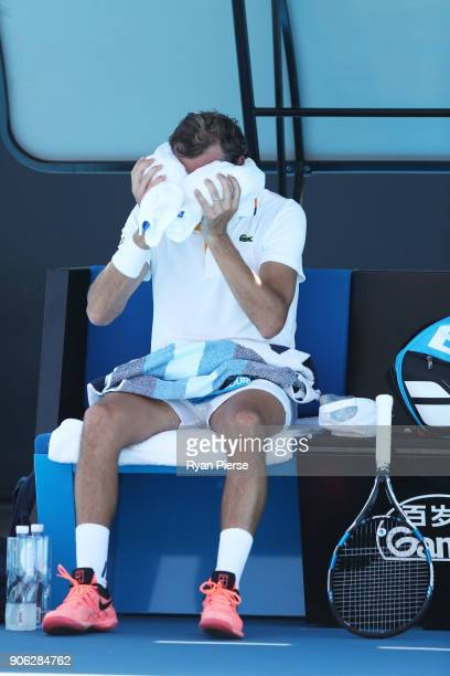 Julien Benneteau of France attempts to cool down between games in his second round match against David Goffin of Belgium on day four of the 2018...