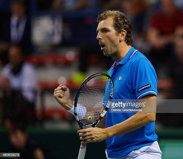 Julien Benneteau of France celebrates during his match against Tobias Kamke of Germany during day 1 of the Davis Cup Quarter Final match between...