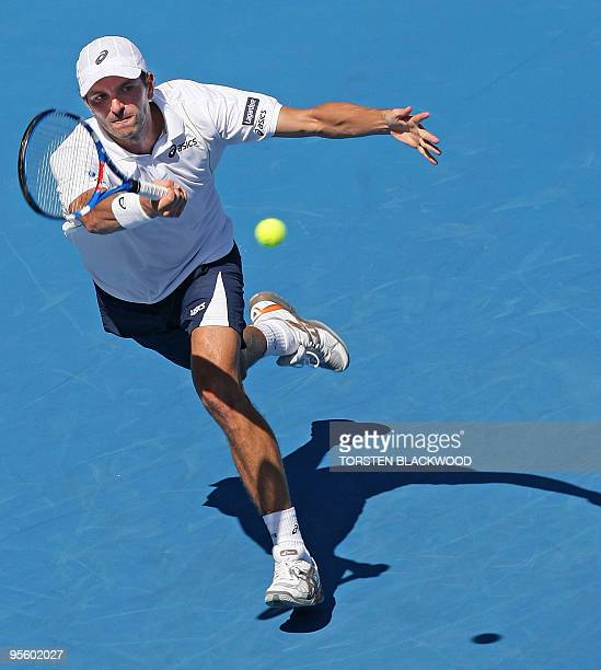 Julien Benneteau of France concentrates on a forehand return to Australia's Lleyton Hewitt during the second round of the Sydney International tennis...