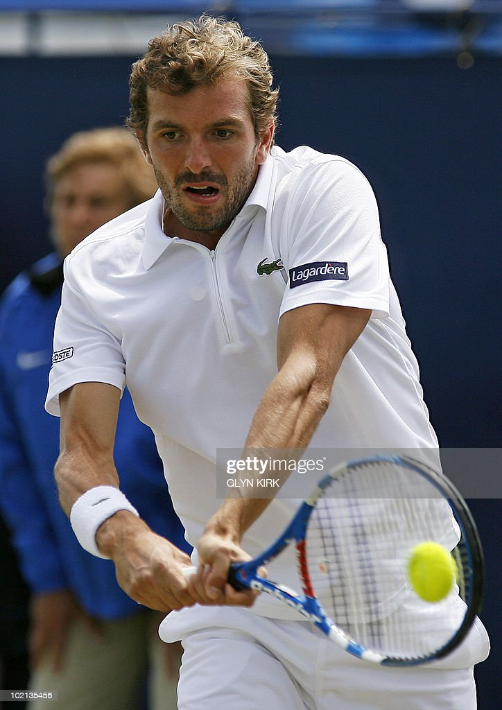 Julien Benneteau of France hits a shot during his second round singles match against Dudi Sela of Israel on the third day of the AEGON International tennis tournament in Eastbourne, southern England, on June 16, 2010.