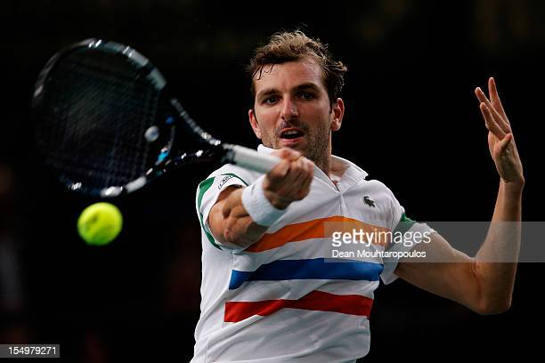 Julien Benneteau of France in action against Viktor Troicki of Serbia during day 1 of the BNP Paribas Masters at Palais Omnisports de Bercy on...
