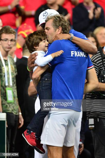 Julien Benneteau of France kisses his son during Day 2 of the Davis Cup semi final on September 15 2018 in Lille France