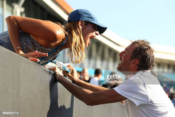 Julien Benneteau of France kisses his wife Karen after winning his second round match against David Goffin of Belgium on day four of the 2018...