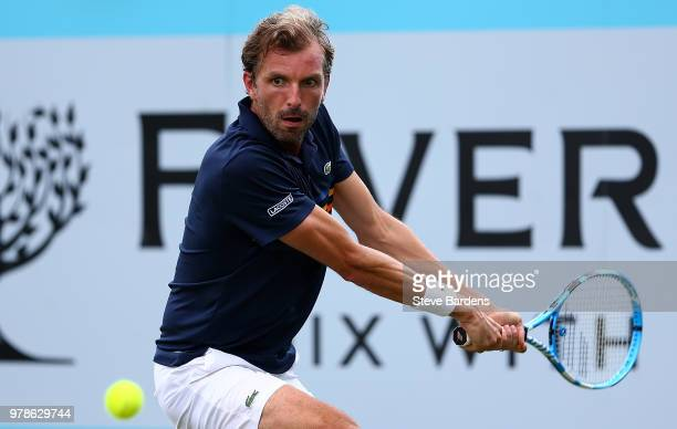 Julien Benneteau of France plays a backhand during his match against Tomas Berdych of The Czech Republic on Day Two of the FeverTree Championships at...