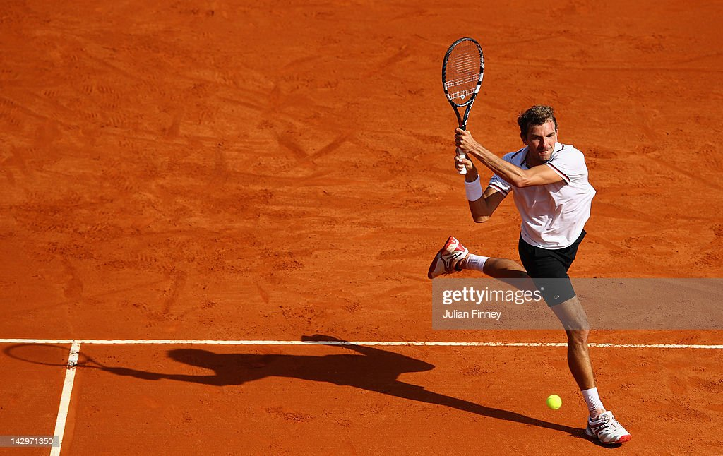 Julien Benneteau of France plays a backhand in his match against Marcel Granollers of Spain during day two of the ATP Monte Carlo Masters on April 16, 2012 in Monte-Carlo, Monaco.