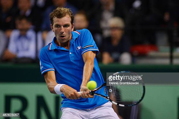 Julien Benneteau of France plays a backhand in his match against Tobias Kamke of Germany during day 1 of the Davis Cup Quarter Final match between...