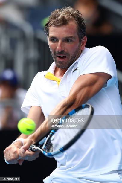 Julien Benneteau of France plays a backhand in his third round match against Fabio Fognini of Italy on day six of the 2018 Australian Open at...